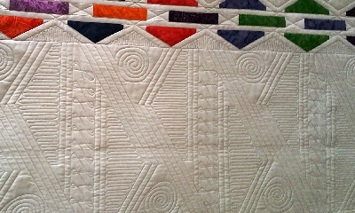 Lyn Crump has developed a long arm aesthetic for the more modern quilts she works on